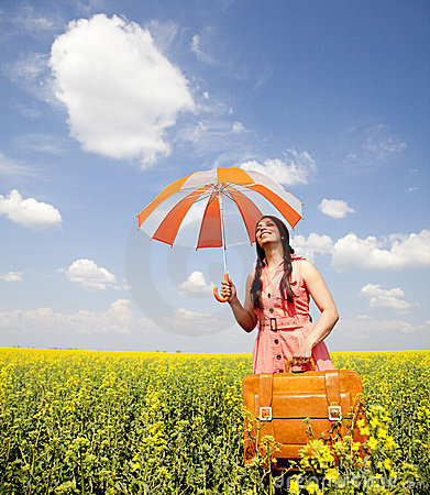 Free Girl With Umbrella And Suitcase At Spring Field. Royalty Free Stock Photo - 23423105