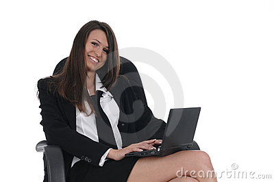 Girl witn netbook in chair