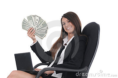 Girl witn netbook and money in chair