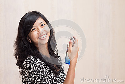 Beautiful Asian girl with perfume