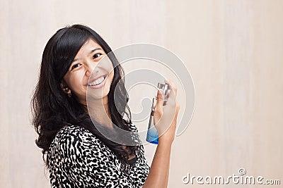 Beautiful Asian girl with perfume