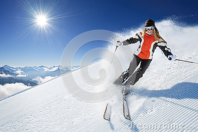 Girl / Woman / Female On the Ski at sunny day