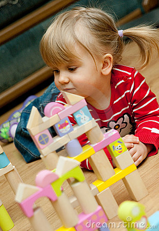 Girl with wooden blocks