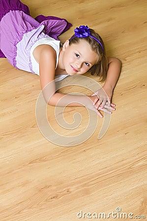 Girl on wooden floor
