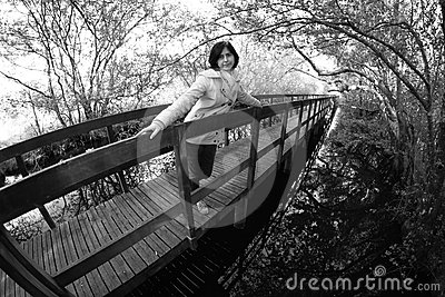 Girl in wooden walkway
