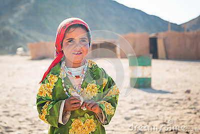 Girl working with camels in Bedouin village on the desert Editorial Stock Image