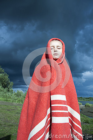 The girl wrapped in a red blanket