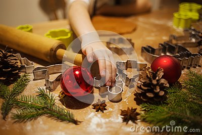 Girl writes a letter to Santa Claus in room with bed and Christmas tree in blue and gold colors Stock Photo