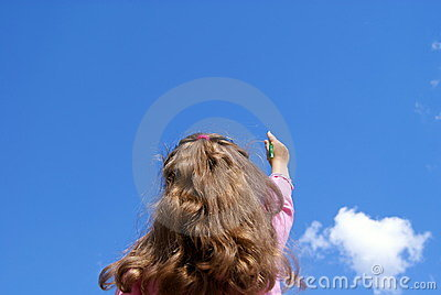 The girl writes in the sky