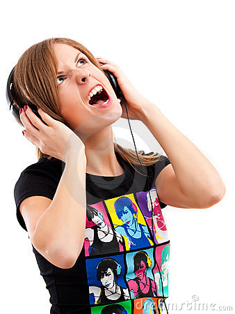 Girl yelling song with headphones