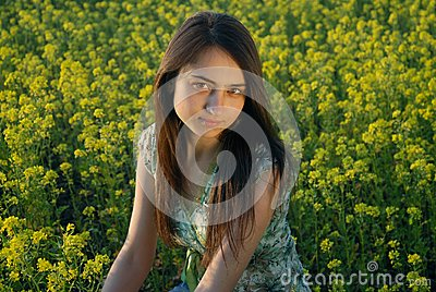 Girl on a yellow canola field