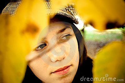 Girl through yellow leaves