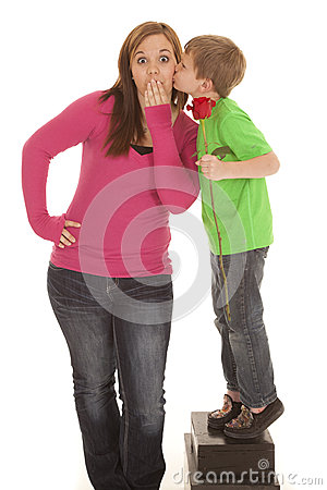 Girl and young boy hold rose kiss cheek