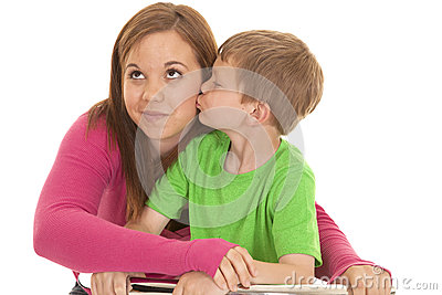 Girl and young boy kiss her look up
