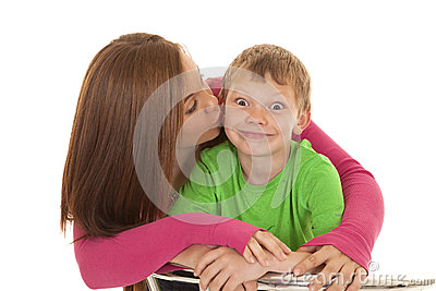 Girl and young boy kissed funny face