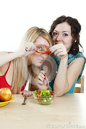 Girlfriends cheerfully play with food