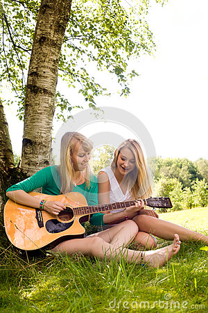 Girlfriends playing with the guitar