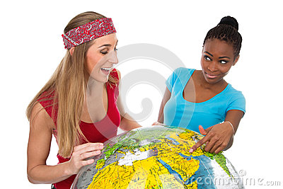 Girlfriends search for destination with globe isolated on white