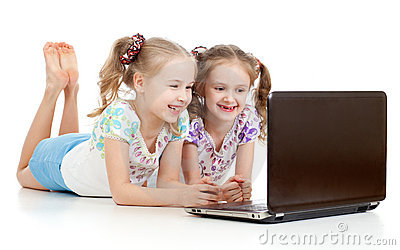 Girlfriends smiling looking at the laptop