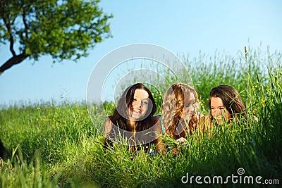 Girlfriends under tree