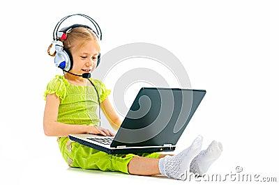Girlie in earphones with laptop
