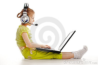 Girlie in headphones with laptop