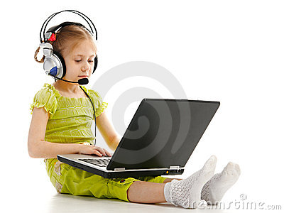 Girlie in headphones with laptop