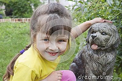 Girlie  near to concrete dog