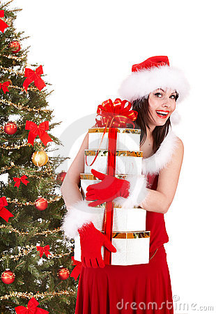Girll in santa hat and fir tree with gift box.
