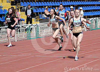 Girls on the 100 meters race Editorial Image