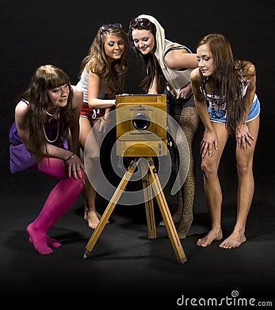 Girls admiring antique camera