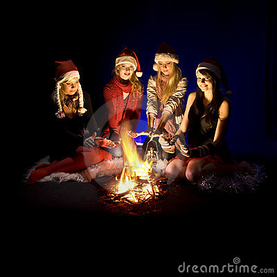 Girls around campfire