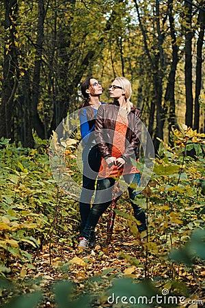 Girls in autumn forest