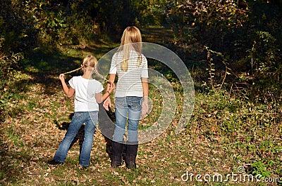 Girls in autumn woods