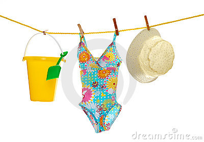 Girls beach wear and toys on clothes line