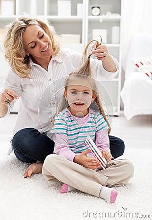 Girls beauty ritual - combing hair