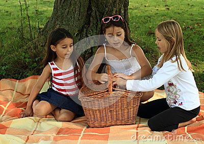 Girls on blanket with basket