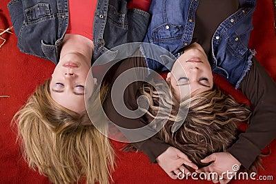 Girls on blanket eyes closed top view