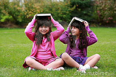 Girls with books on head