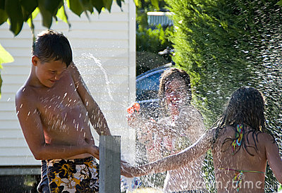 Girls and boy and hydrant fun