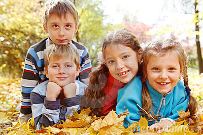 Girls and boys in autumnal park
