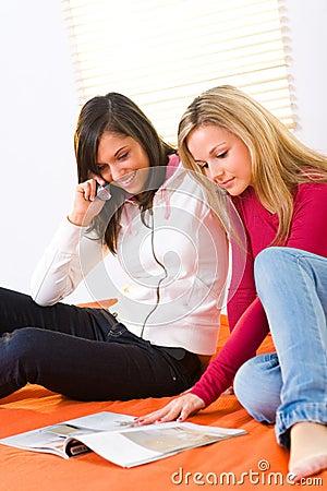 Girls browsing magazine