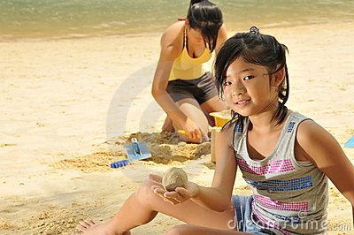 Girls Building Sandcastle By The Beach