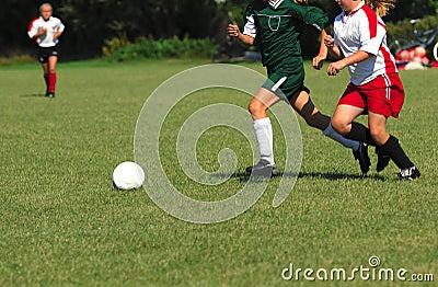 Girls Chasing A Soccer Ball