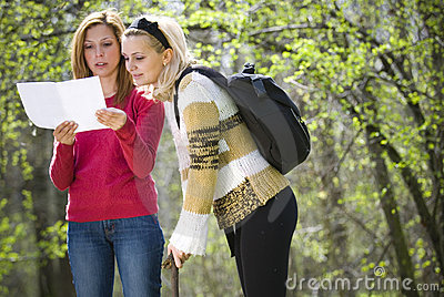 Girls checking a map