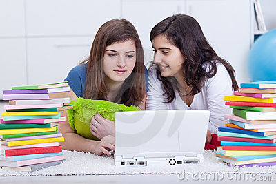 Girls in college study together