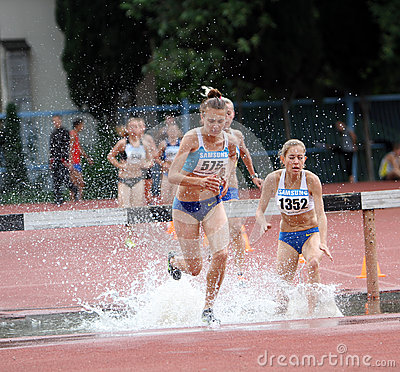 Girls compete in the 3.000 Meter Steeplechase Editorial Image