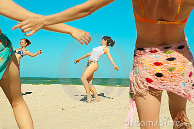 Girls dancing at the beach