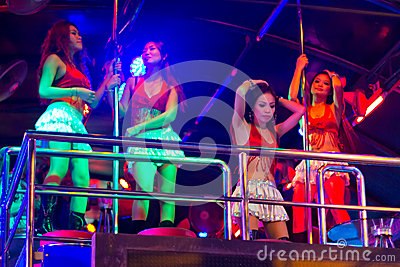 Girls dancing on the pole in the nightclub of Patong Editorial Photography