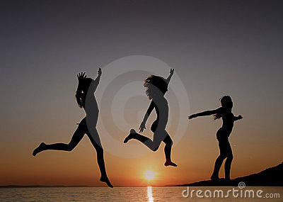 Girls dancing in sunset